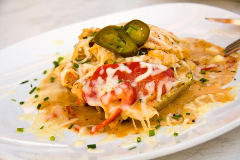 Galinha mexicana com batata, queijo fotos de stock