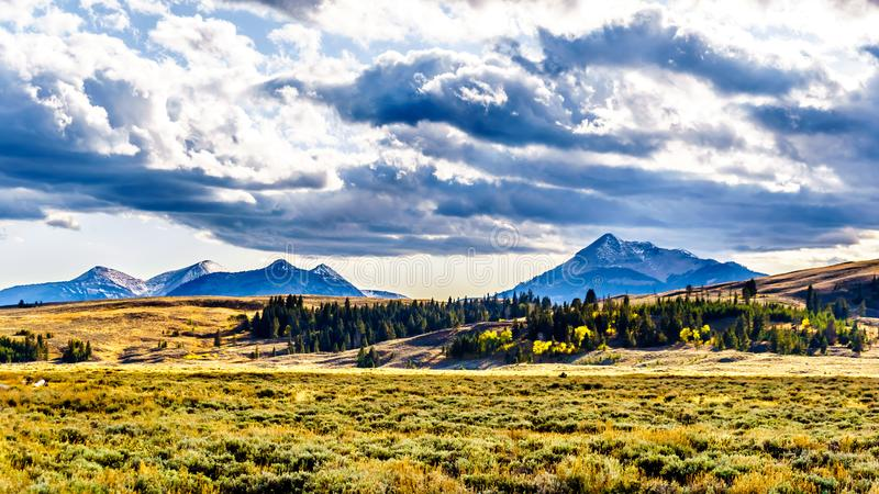 The Gallatin Mountain Range with Electric Peak under later afternoon sun. Viewed from the Grand Loop Road near Mammoth Hot Springs. In Yellowstone National Park stock photos