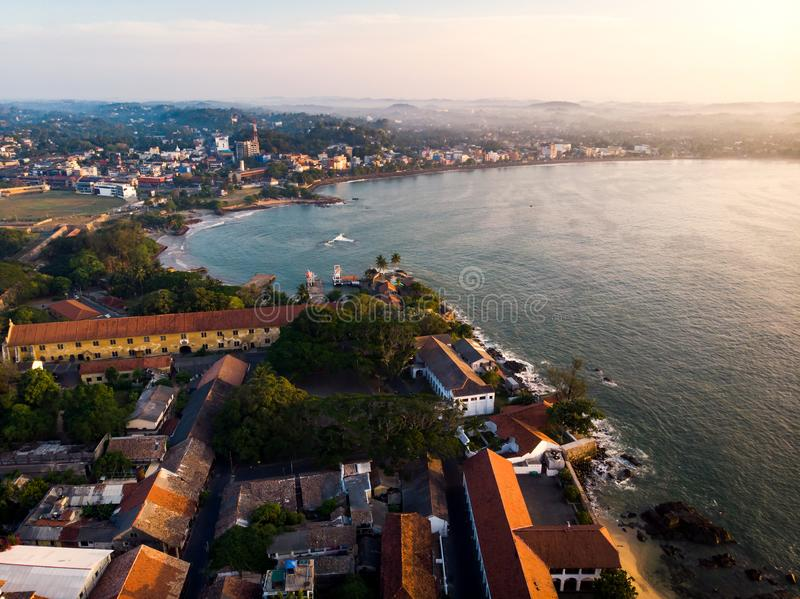 Galle Dutch Fort in Galle city of Sri Lanka aerial. View morning ocean sunrise building lighthouse day coast tropical sky fortress travel tower landmark old sea stock photography
