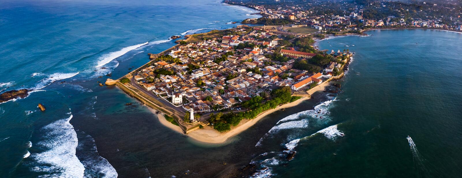 Galle Dutch Fort in Sri Lanka panoramic aerial view. Galle Dutch Fort by the water in Sri Lanka panoramic aerial view morning city panorama sunrise lighthouse stock image