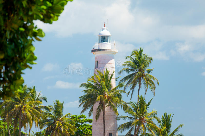 GALLE, SRI LANKA - JANUARY 26, 2016: beautiful lighthouse surrounded with palms on the wonderful sky background in Galle, Sri Lan stock images