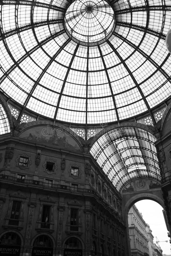 Galleria Vittorio Emanuele II in Milan, Italy. Black and white photograph of the famous Galleria Vittorio Emanuele II, heart of Milan's high fashion market royalty free stock image