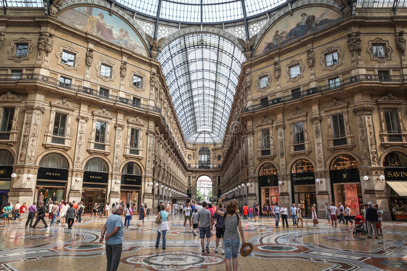 Galleria Vittorio Emanuele II in Milan. Milan, Italy - July 9, 2013: Tourists and shoppers walk inside the Galleria Vittorio Emanuele II, one of the world's
