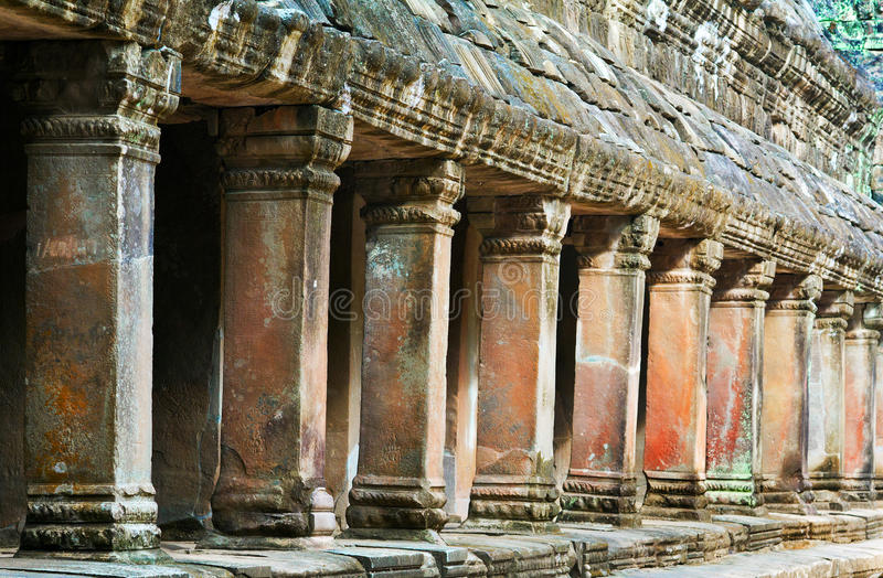 Gallery pillars at Ta Prohm, Siem Reap, Cambodia. King Jayavarman VII, who dedicated the temple to his mother, built Ta Prohm around 1186 CE. This gallery was stock photo