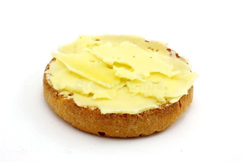 Galleta con mantequilla y queso imagen de archivo