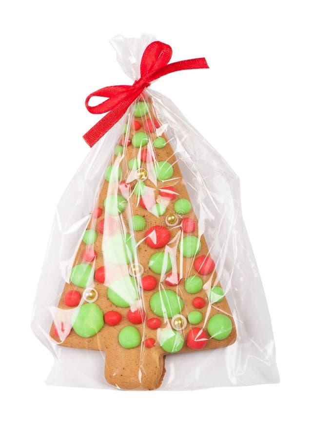 Galleta del árbol del pan de jengibre de la Navidad en el embalaje transparente foto de archivo libre de regalías