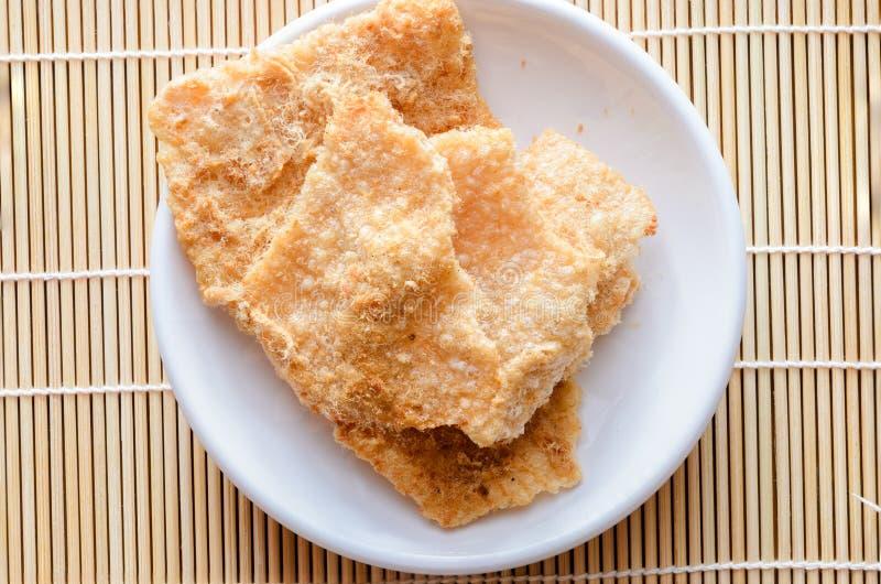 Galleta del arroz con cerdo secado del fragmento imágenes de archivo libres de regalías