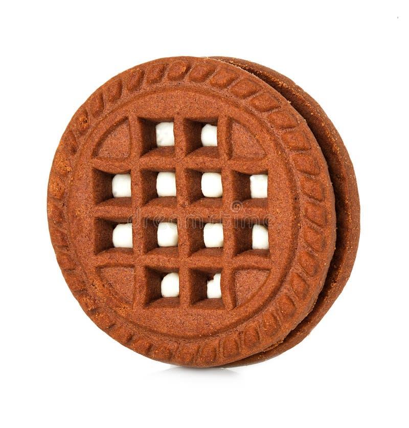 Galleta del chocolate con la limadura de la nata fotografía de archivo