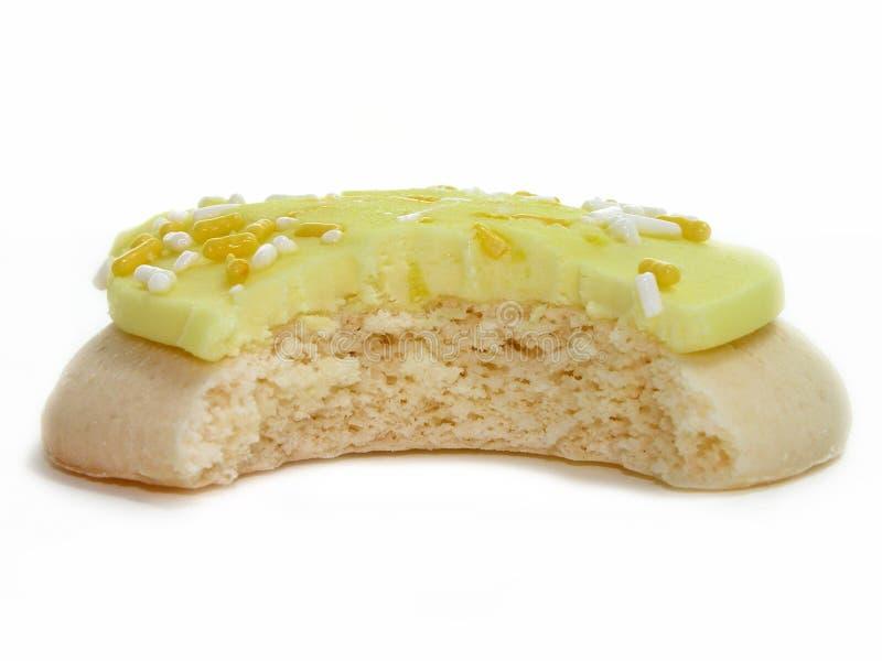 Galleta del limón con la mordedura sacada imagen de archivo libre de regalías