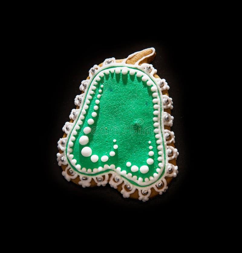 Galleta en forma de pera verde del pan de jengibre, tema de la Navidad fotografía de archivo