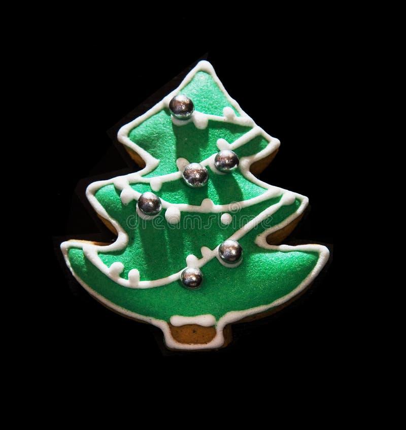 Galleta formada árbol de navidad verde del pan de jengibre fotografía de archivo