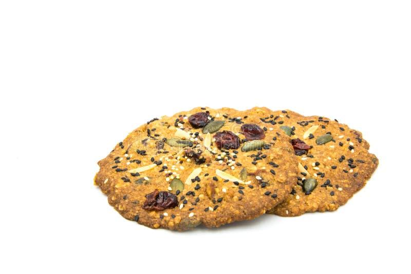 Galleta hecha con el grano, pasa, almendra, semilla de calabaza, anacardo, arándano, nuez, semilla de girasol, Chia Seed, semilla fotos de archivo
