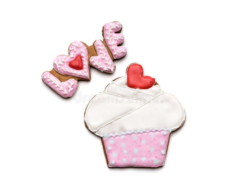 Galletas con el texto del amor y de la torta imagen de archivo libre de regalías