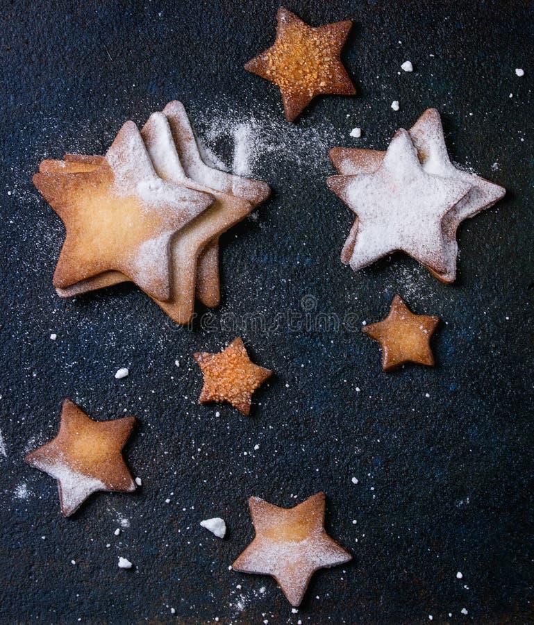 Galletas de azúcar de la forma de la estrella de la torta dulce fotos de archivo