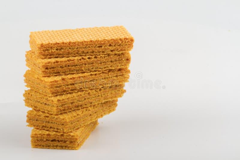 galletas de la oblea apiladas en el fondo blanco imágenes de archivo libres de regalías