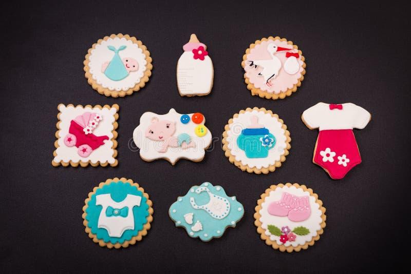 Galletas decorativas para un bebé recién nacido en el bautismo fotografía de archivo