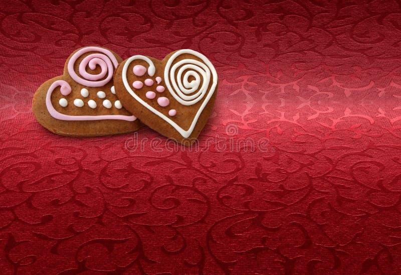 Galletas del pan del jengibre en rojo imágenes de archivo libres de regalías