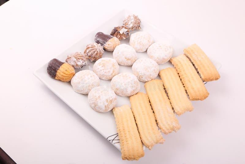 Galletas, fours de los petits y tortas foto de archivo