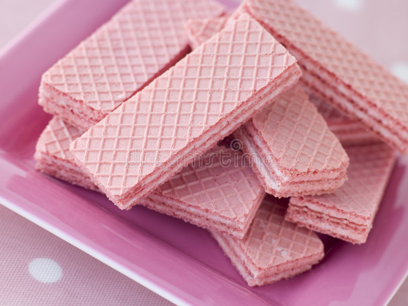 Galletas rosadas de la oblea fotos de archivo