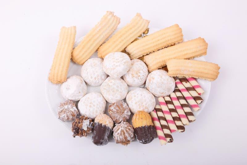Galletas, tortas y fours de los petits foto de archivo