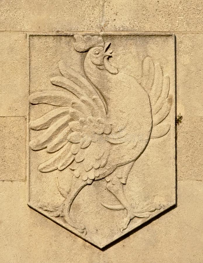 Gallic rooster, heraldic symbol of the french nation, embossed in stone royalty free stock photography