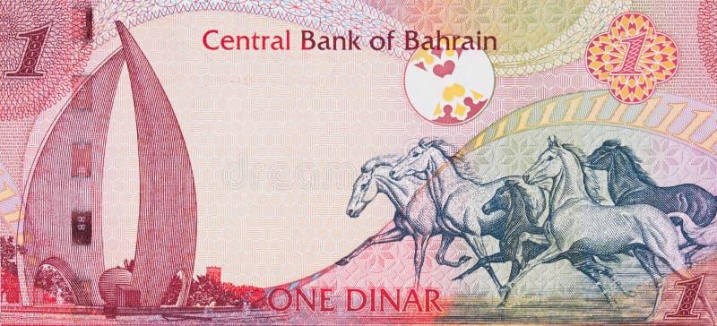 Galloping Arabian Horses and the Sail and Pearl monument on Bahrain one dinar (2006) banknote closeup macro, Bahraini money close stock photos