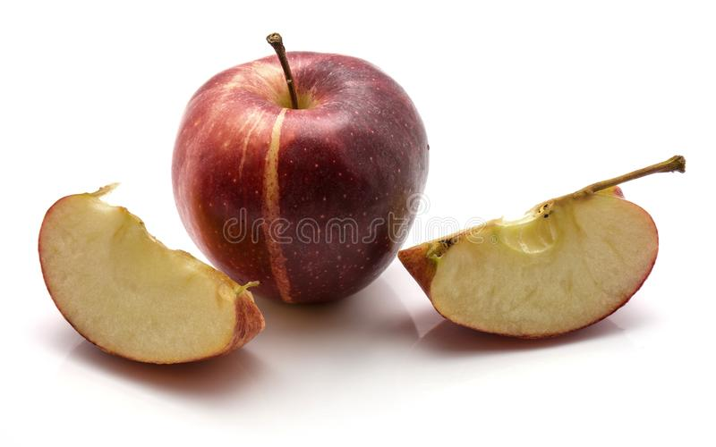 Galowy jabłko i dwa plasterka odizolowywających na białym tle obrazy stock