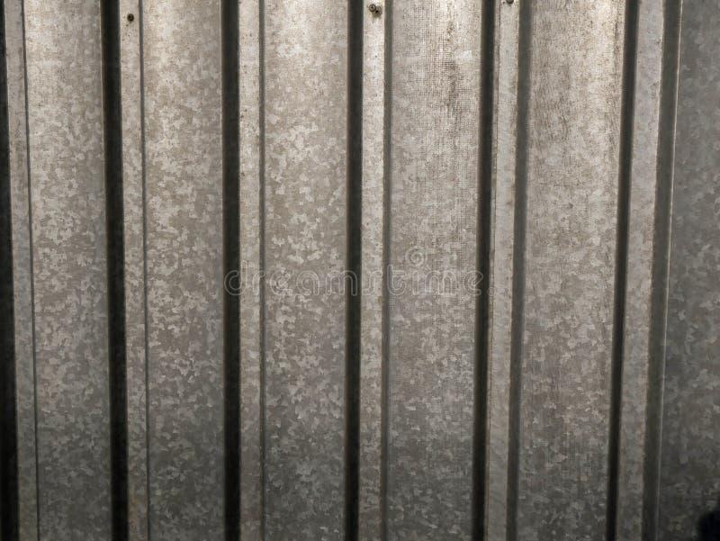 Galvanised sheet steel garden fence close up shot stock illustration