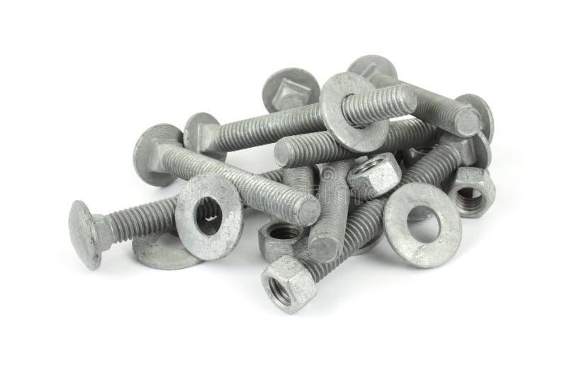 Galvanisierte Stahlmuttern, Schrauben und Scheiben stockfotografie