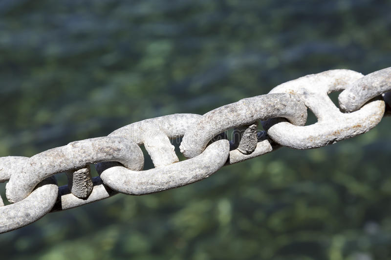 Galvanized chain, mooring line. Galvanized chain mooring line being shown on the background color of the sea royalty free stock photography