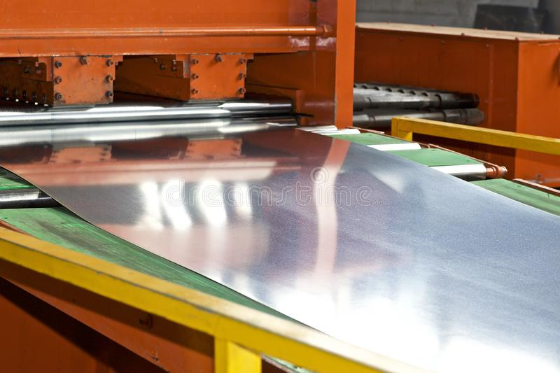 Galvanized sheet in the machine for further processing stock photo