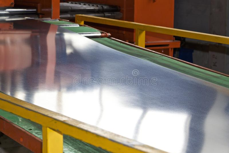 Galvanized sheet in the machine for further processing stock images