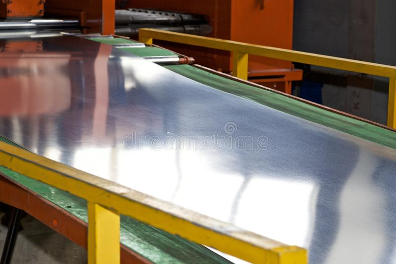 Galvanized sheet in the machine for further processing royalty free stock photography