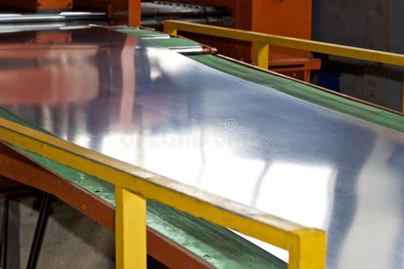 Galvanized sheet in the machine for further processing royalty free stock image