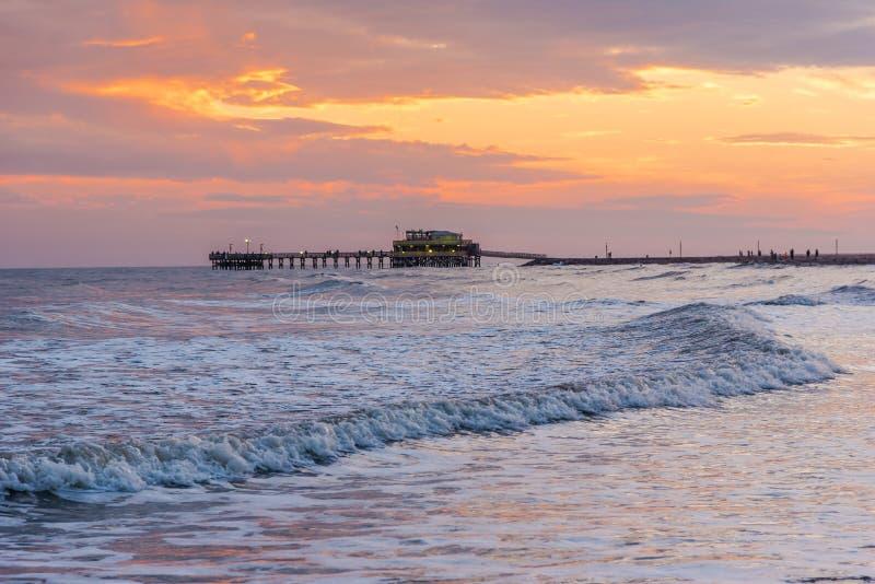 Galveston Island, Texas. Sunrise behind the Historic Pleasure Pier on Galveston Island, Texas in the Gulf of Mexico stock image
