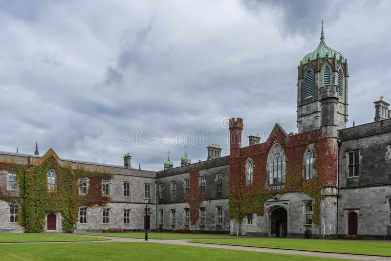 Iconic historic Quadrangle and clock tower at NUI Galway, Ireland. Galway, Ireland - August 5, 2017: Part of historic Quadrangle on National University of stock photos