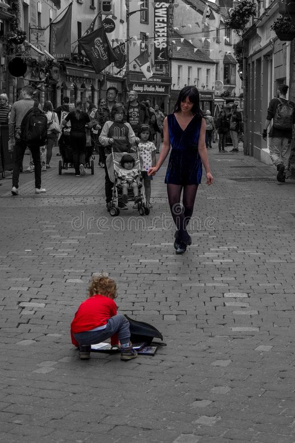 GALWAY, IRELAND - June 2, 2018 - Lady dancer perform traditional. Irish dance, curious cute kid standing in front royalty free stock photos