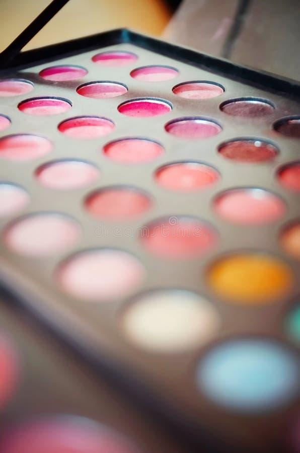 Gama de colores colorida de las sombras de ojo Fondo del maquillaje de Blured fotos de archivo
