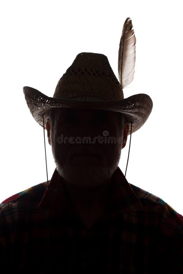 Gamal man i cowboyhatten, främre sikt - mörk närbildkontur royaltyfri bild