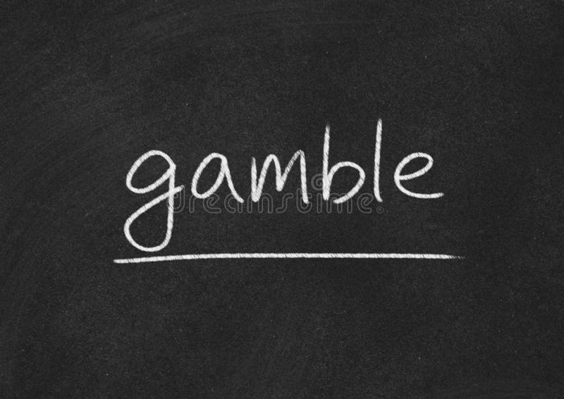 Gamble. Concept word on blackboard background royalty free stock photo
