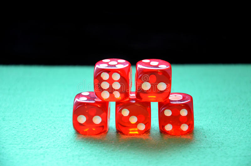 Gamble dices. On green table royalty free stock image