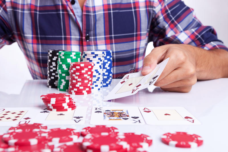 Gambler shows winner poker hand royalty free stock photography