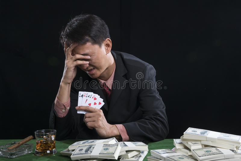 The gambler used a hand off the face with the stress royalty free stock images