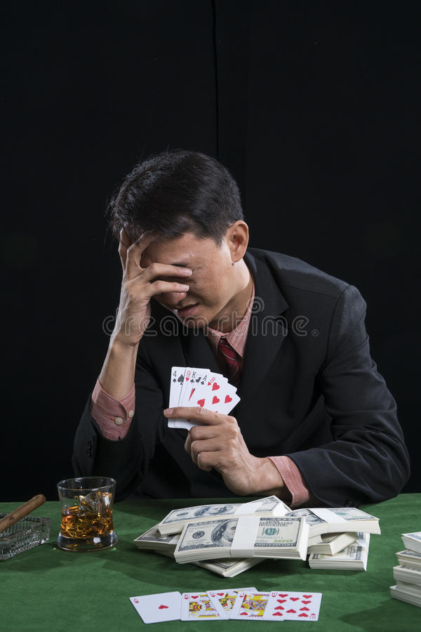 The gambler used a hand off the face with the stress when he def stock photo