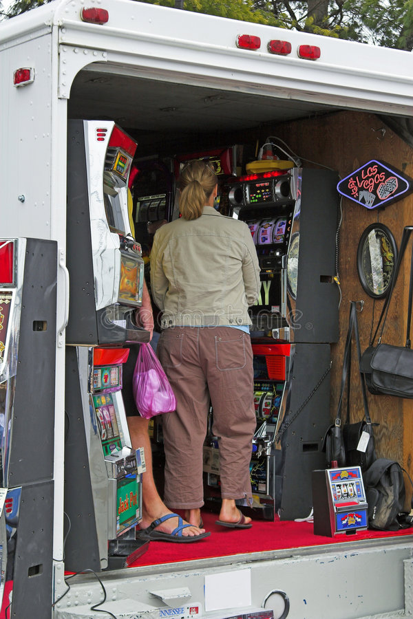 Gambling. Rolling slot machines moving from one place to another by truck stock photo