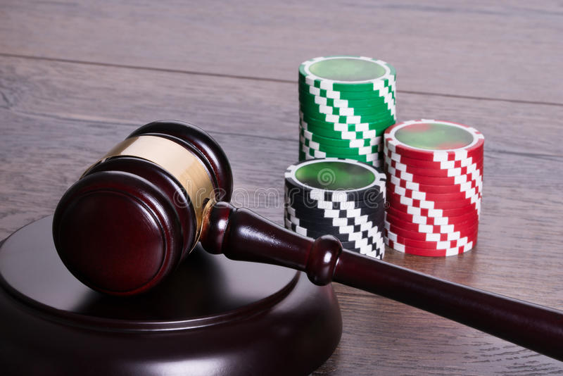 Gambling legal concept. Casino chips and gavel in gambling legal concept stock photos