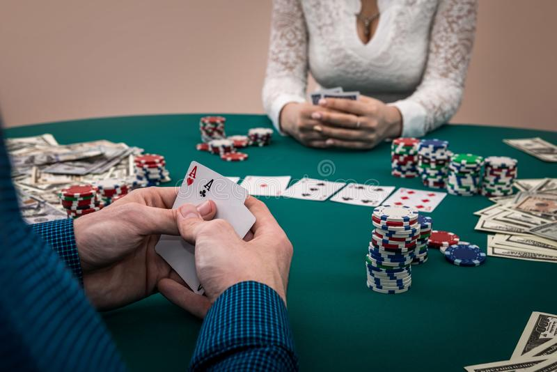 Gambling, players in poker face to face stock photo