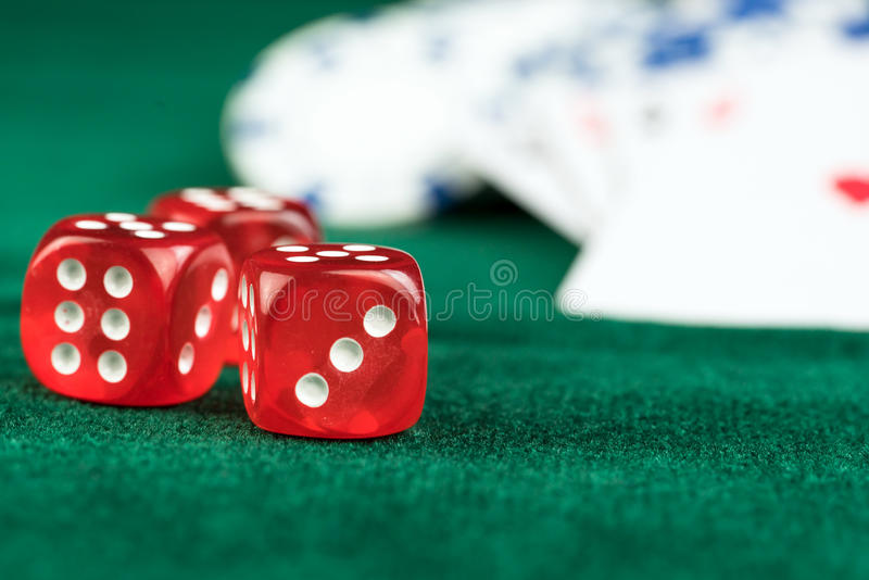 Gambling Red Dice Poker Cards and Money Chips. Gambling Red Dice PokerCards and Money Chips Photo stock photo