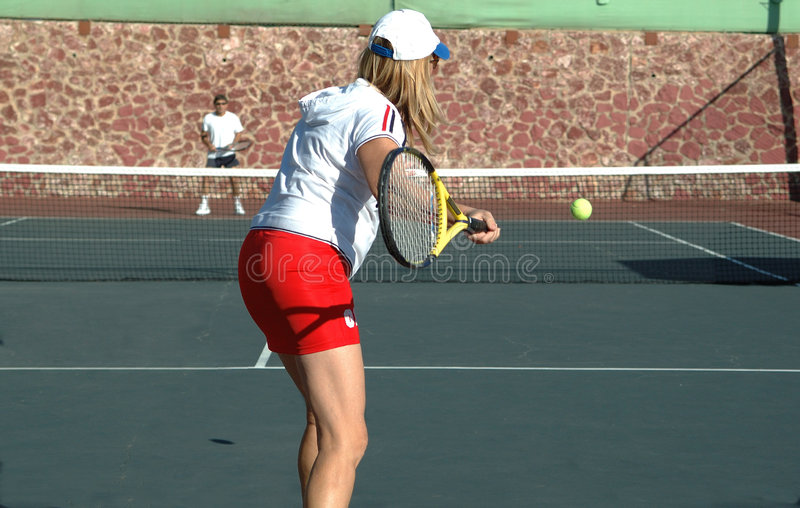 Game. Couple playing tennis