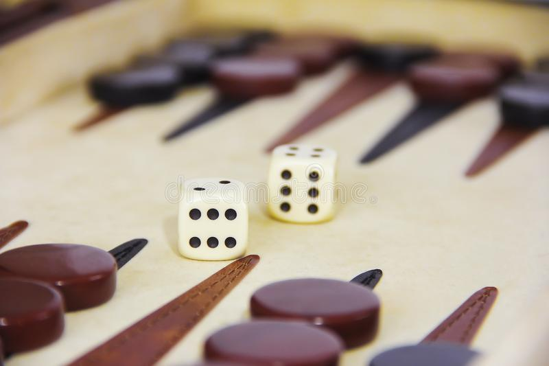 Game backgammon on a board with dices and checkers stock photos